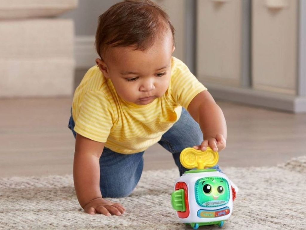 Baby playing with LeapFrog Busy Learning Bot