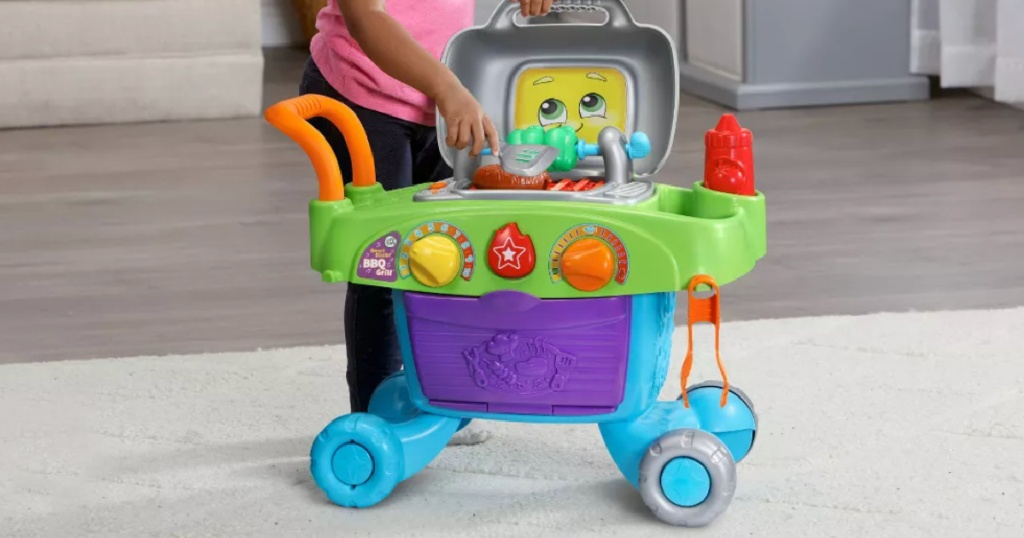 child playing with LeapFrog Smart Sizzlin' BBQ Grill