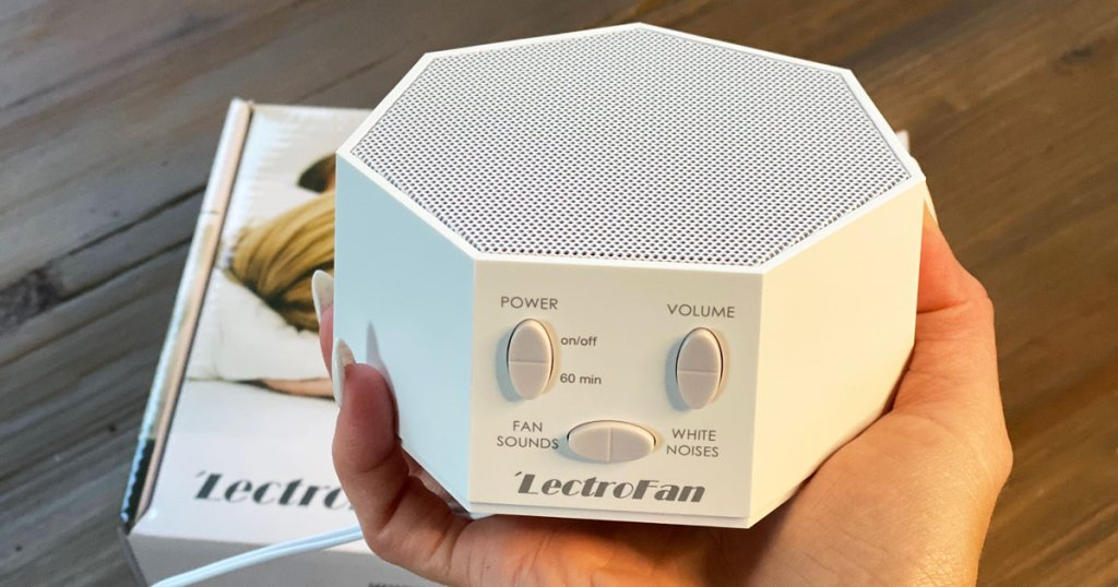 person holding up a lectrofan white noise machine