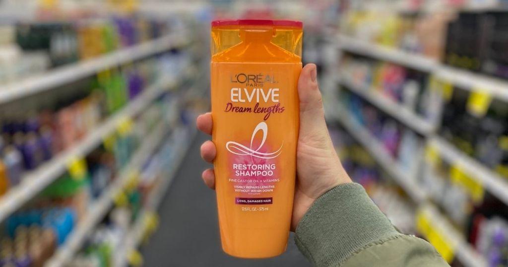 Hand holding Loreal Elvive Shampoo