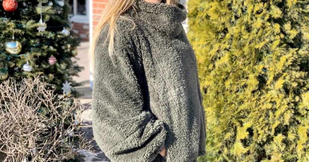 woman standing outside wearing a sherpa lululemon fleece top
