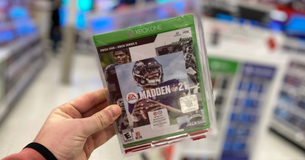 hand holding madden football game