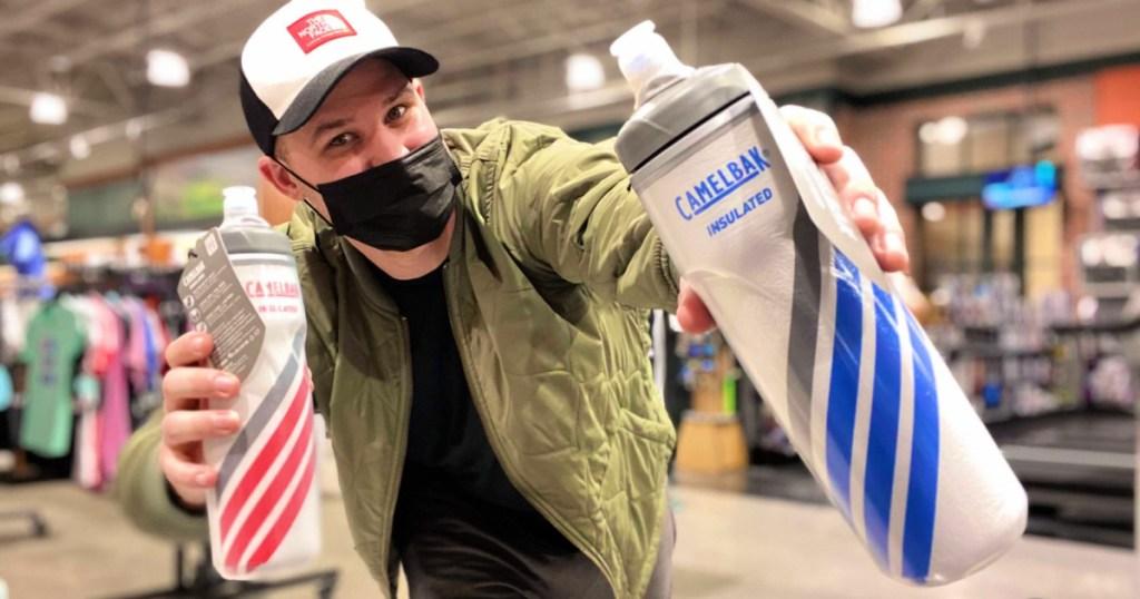 Man holding camelbak water bottles