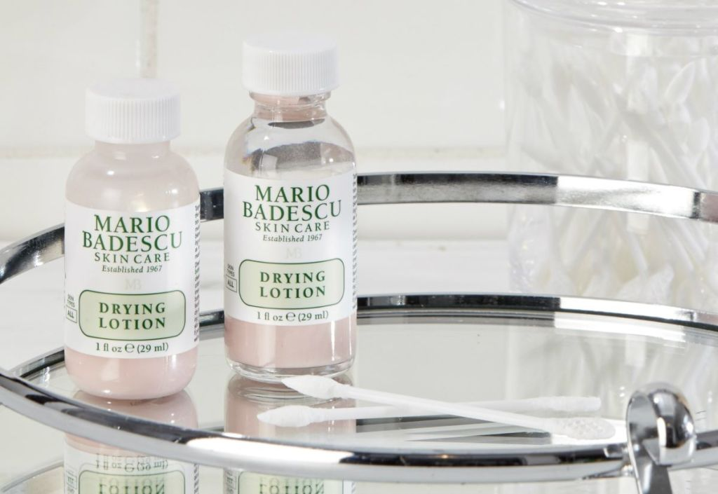 two bottles of Mario Badescu Drying Lotion on a mirror