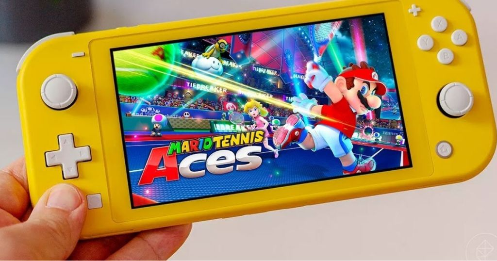 hand holding yellow nintendo switch lite with Mario Tennis Aces for Nintendo Switch on screen