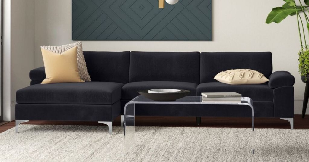 black couch with pillows on it