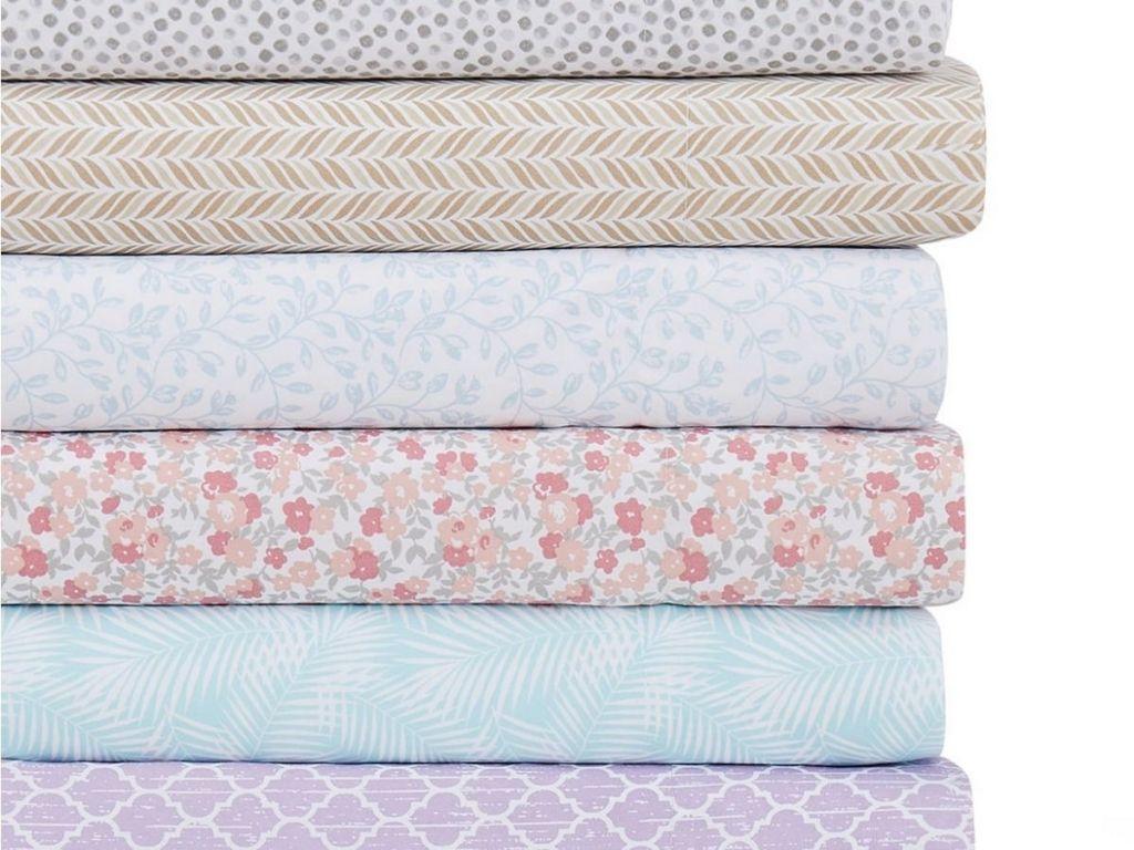 stack of Martha Steward Printed Sheet Sets