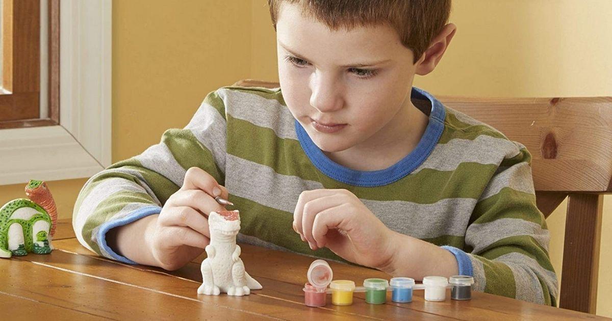 boy painting Melissa & Doug Dinosaur Figurines Kit