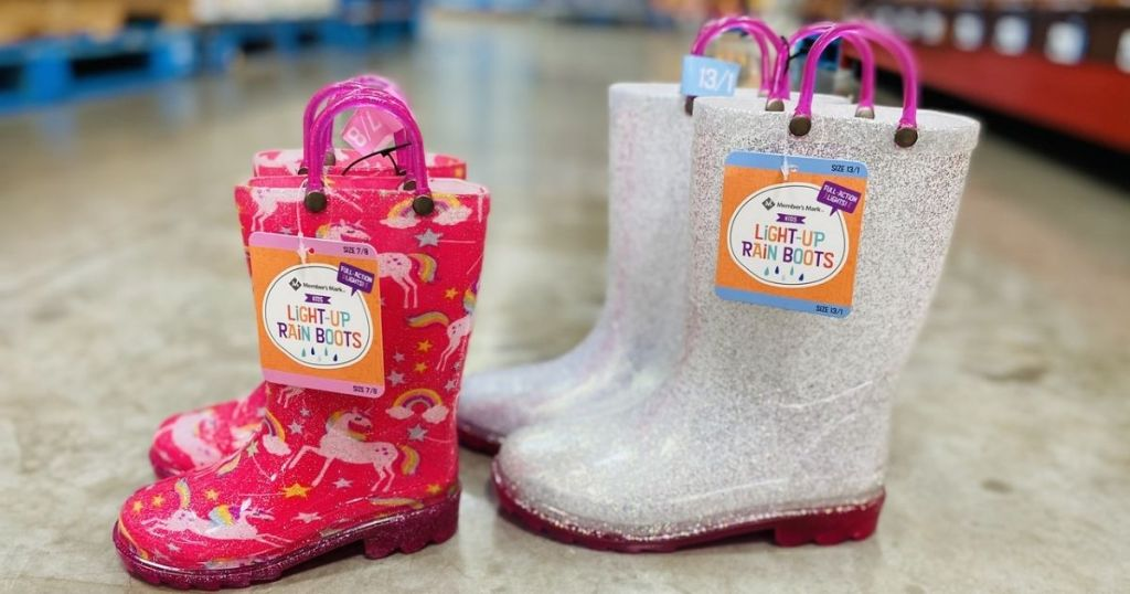2 pair of kids Members Mark Light-Up Rain Boots on floor in store