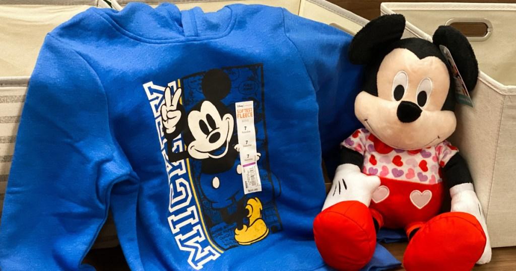 Mickey Sweatshirt next to plush toy