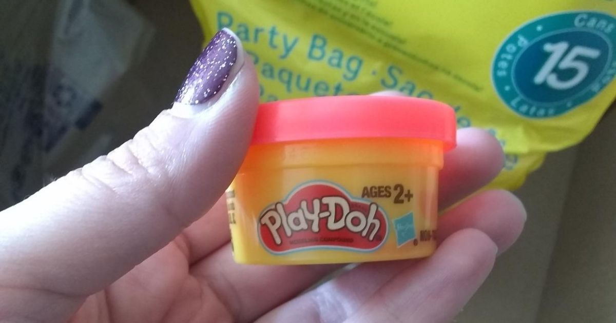 hand holding Mini Play-Doh Party Pack
