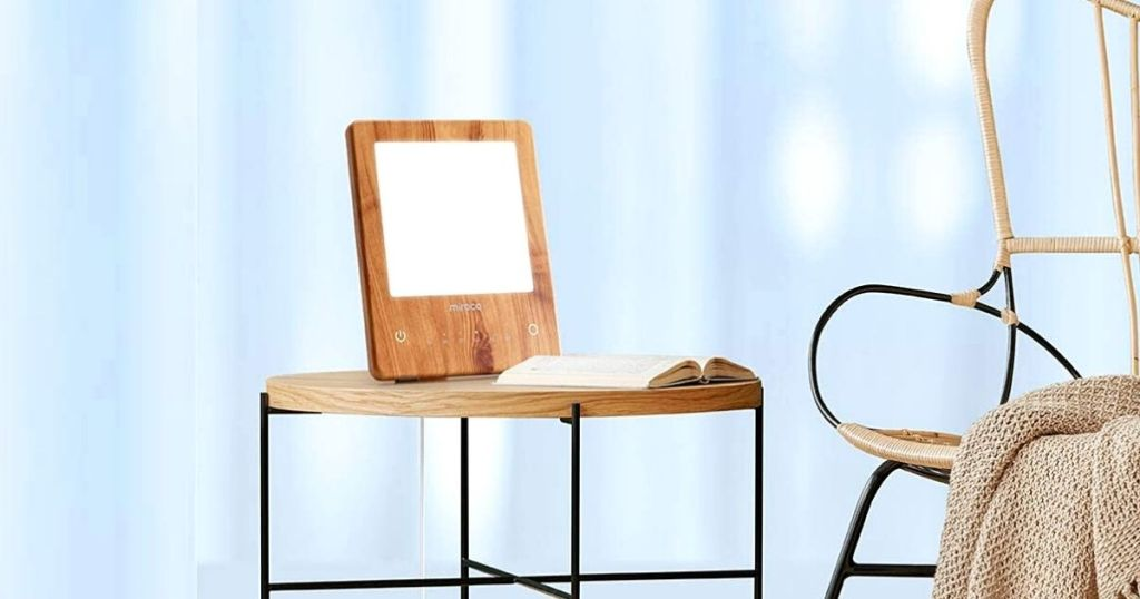 light therapy lamp on side table