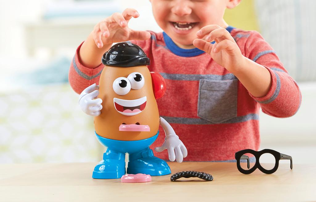 boy playing with Mr Potato Head