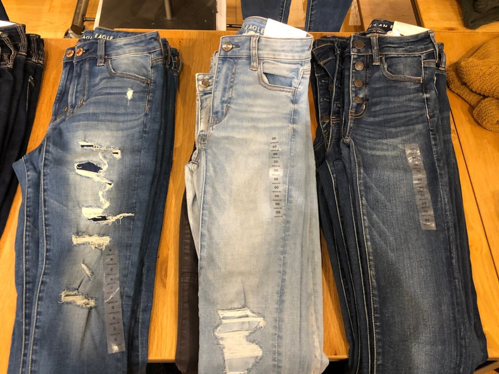 three pairs of american eagle distressed jeans