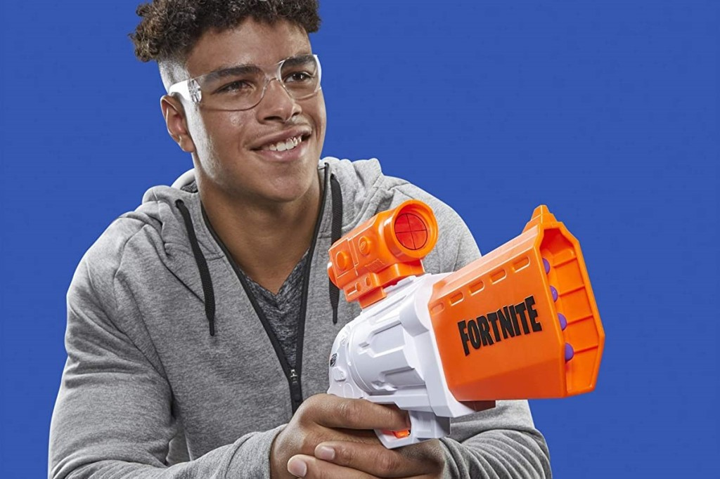 teen boy playing with a NERF blaster