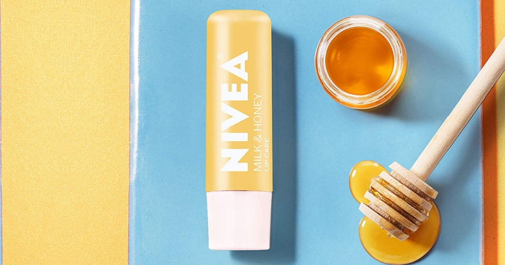 NIVEA brand lip balm near fresh honey