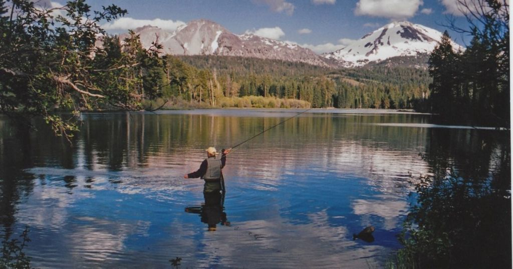 National Park Service with man Fly Fishing