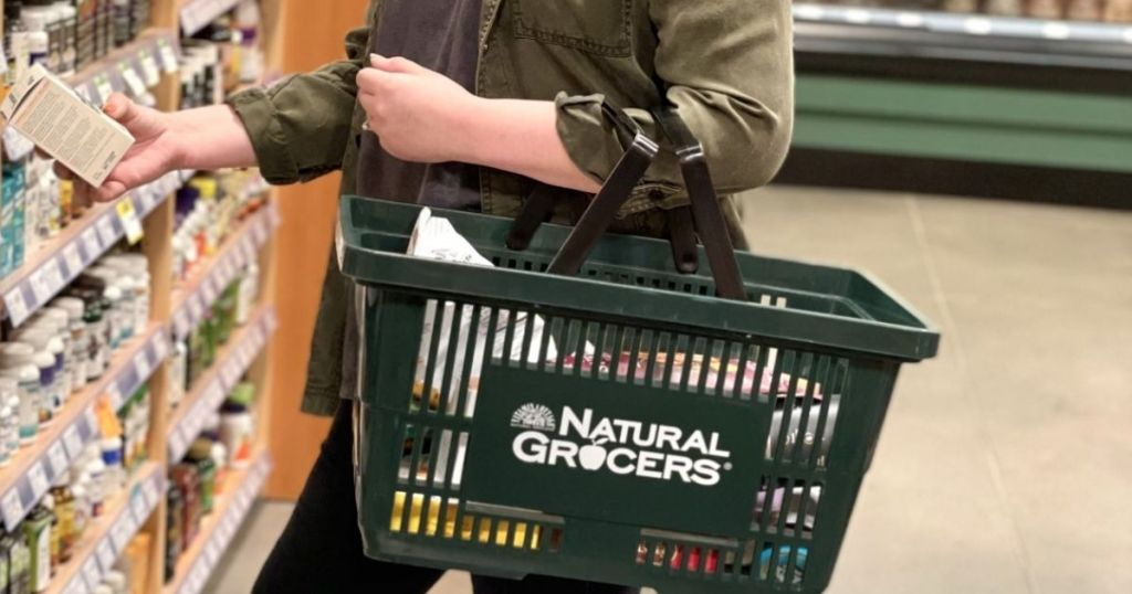 lady with Natural Grocers shopping basket