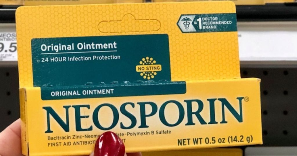 holding Neosporin original ointment