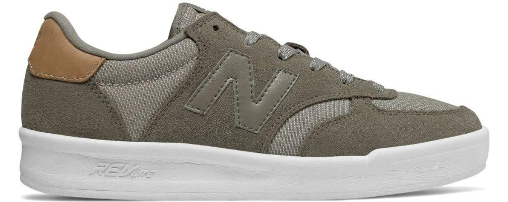 tan and white New Balance shoe