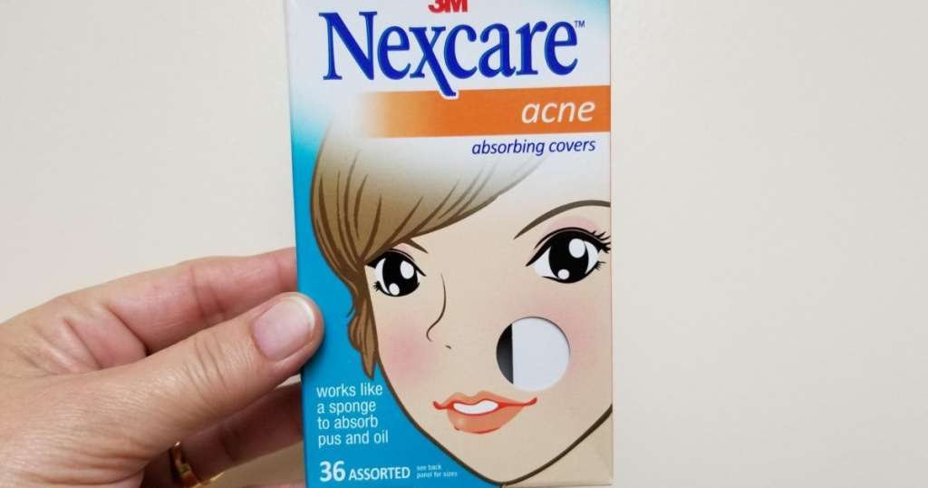 hand holding box of Nexcare Acne Blemish Covers