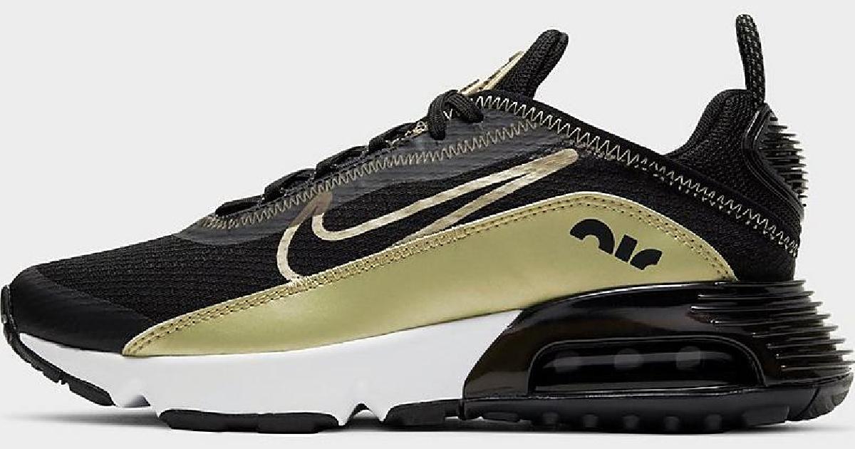 black and gold pair of nike big kids air max