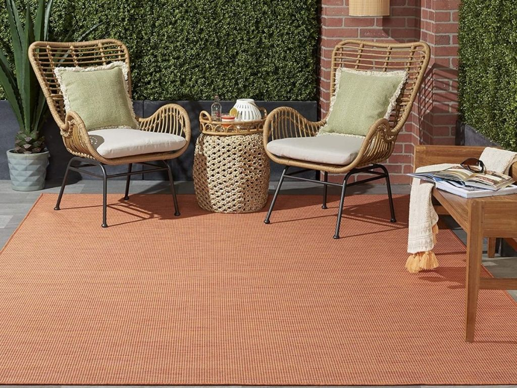 Outdoor space with area rug and patio style furniture