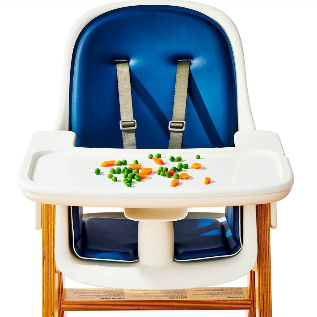 highchair with veggies on the tray