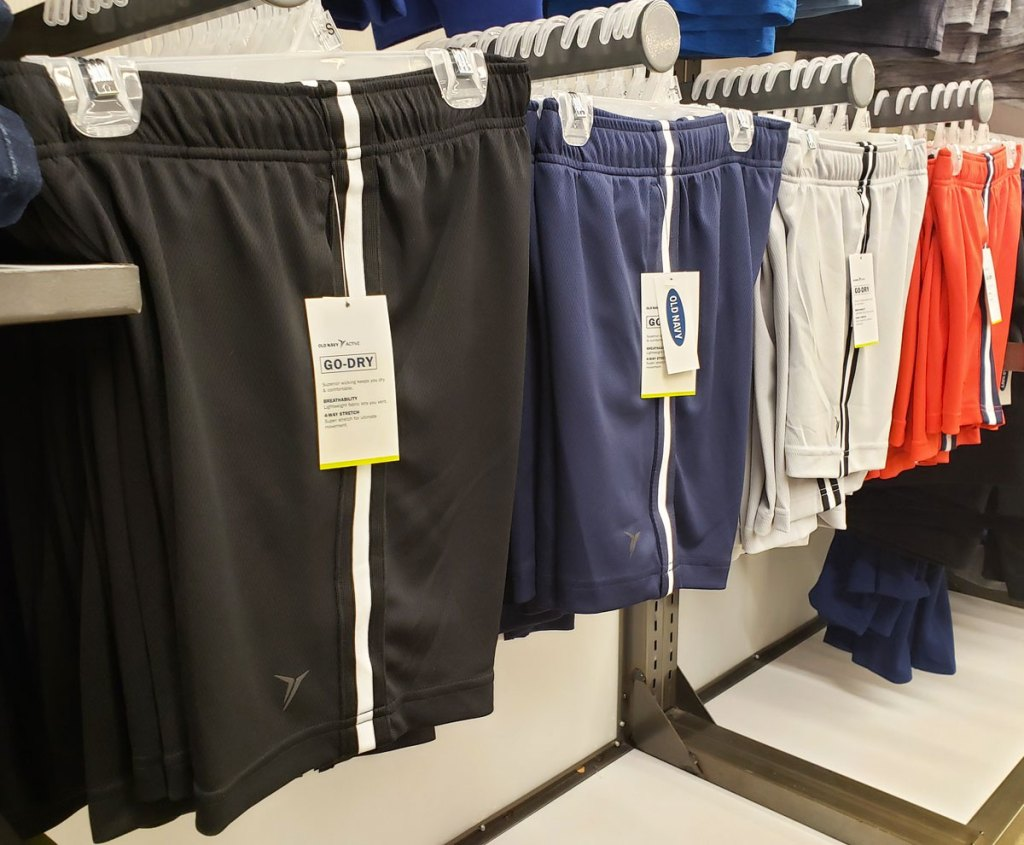 pairs of boys active shorts on display wall at old navy