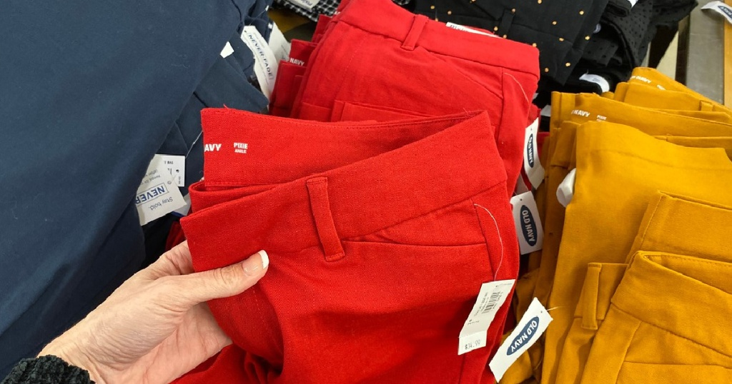 hand holding a pair of red old navy pixie pants
