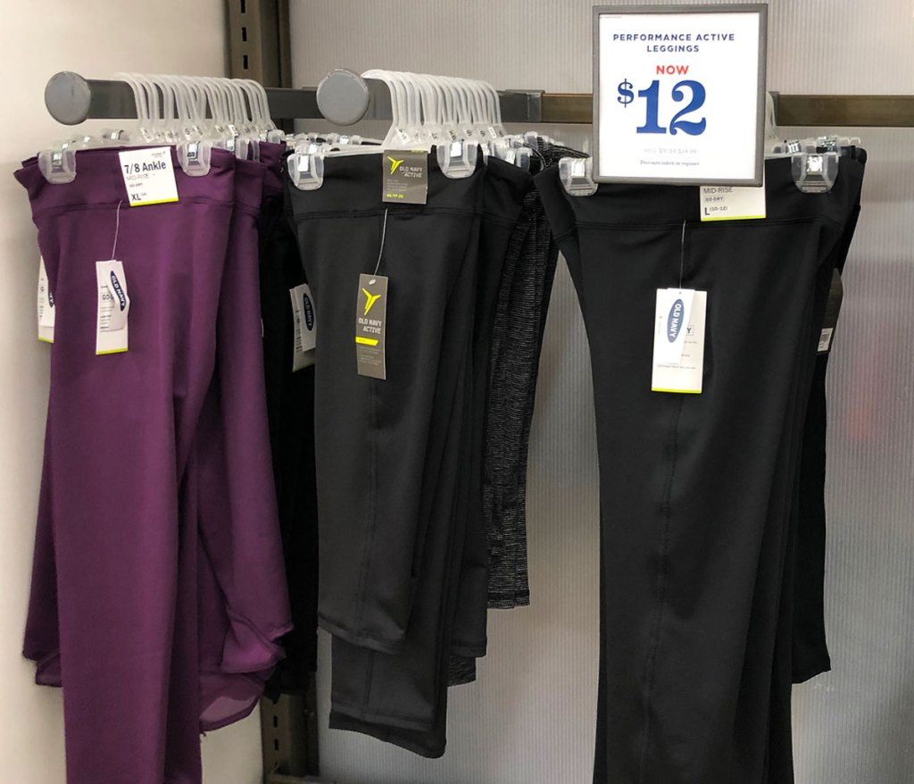 women's active leggings on display with $12 sale sign at old navy