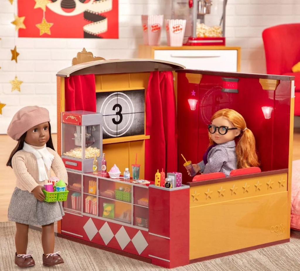 two our generation dolls with movie theatre set up