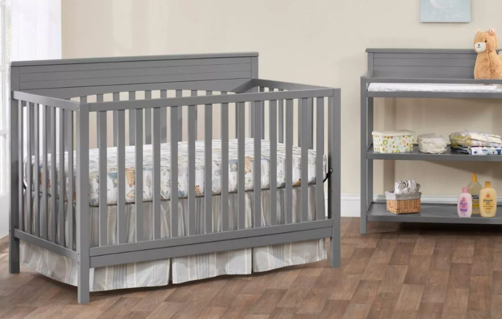nursery with crib and changing table