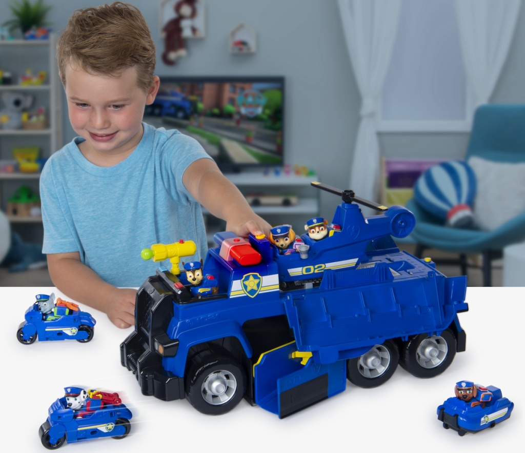 boy playing with PAW Patrol Chase's 5-in-1 Ultimate Cruiser with Lights and Sounds