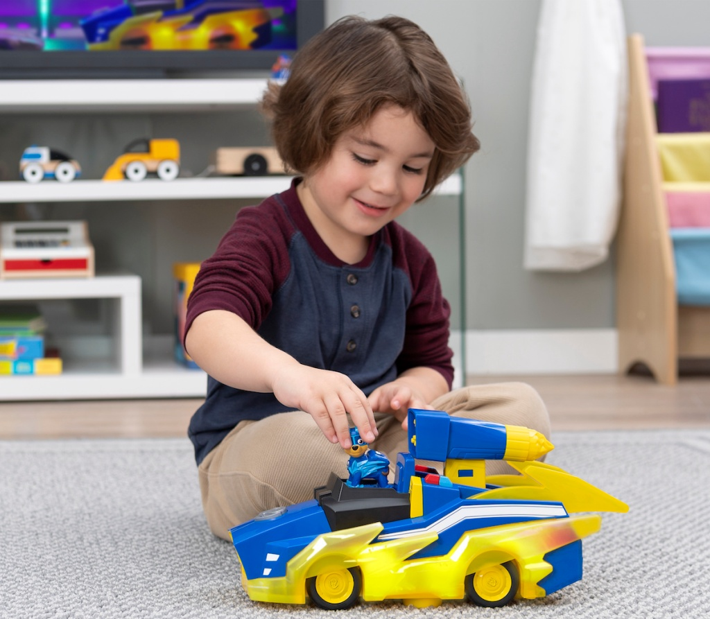 boy playing with PAW Patrol True Metal Mighty Meteor Die-Cast Track Set with Exclusive Chase Vehicle
