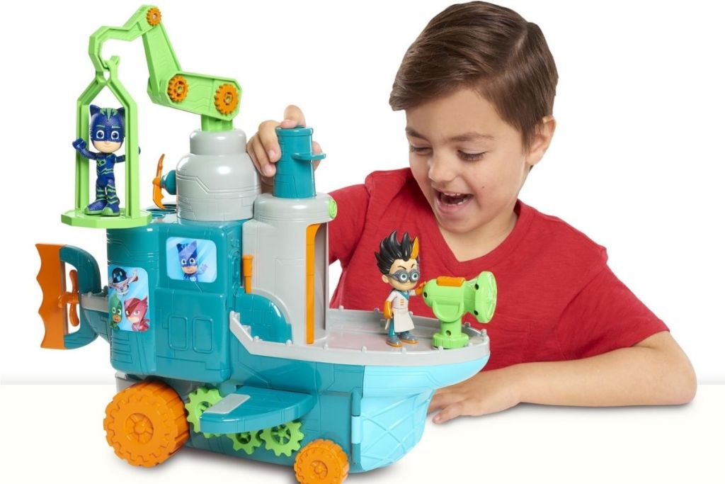 boy playing with PJ Masks Romeo's Flying Factory Play Set