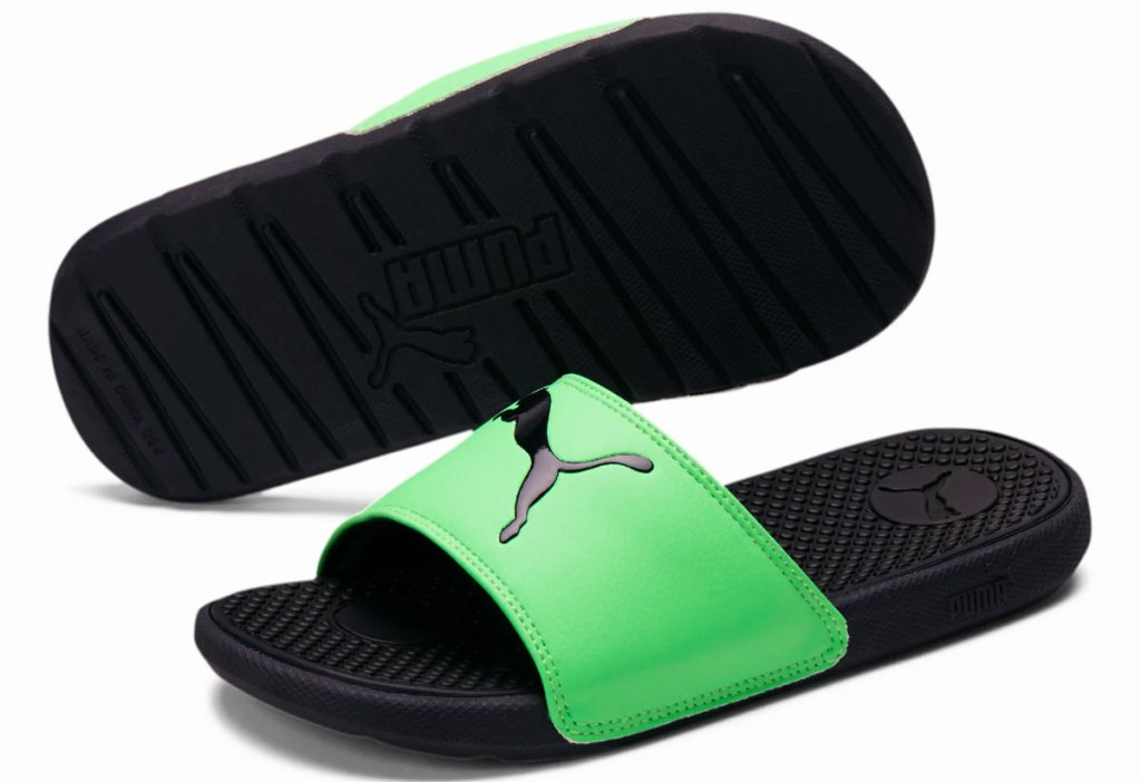 pair of green and black puma kids slides