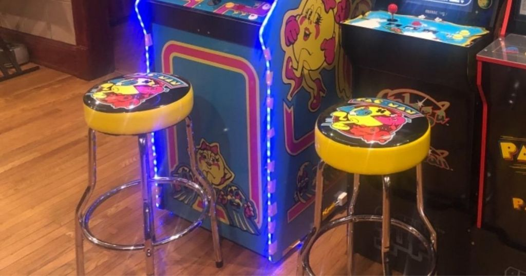 two pacman stools in front of gaming center