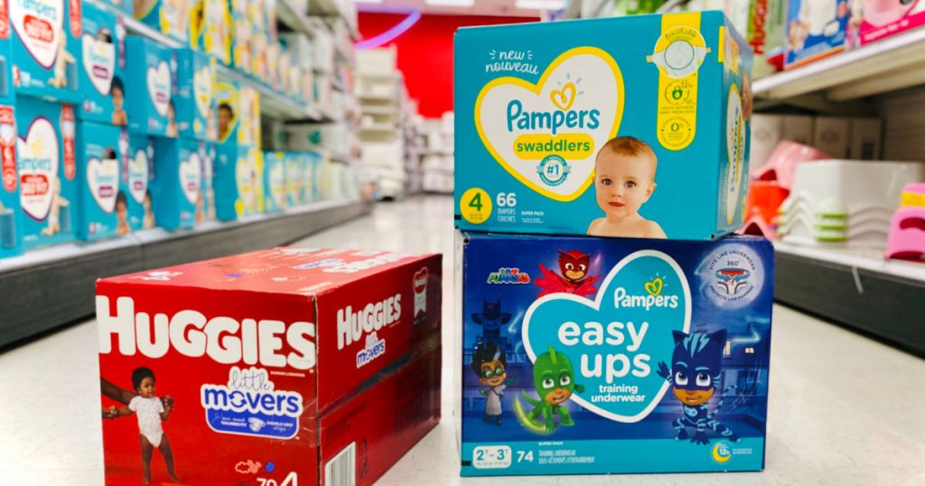 three boxes of diapers in aisle