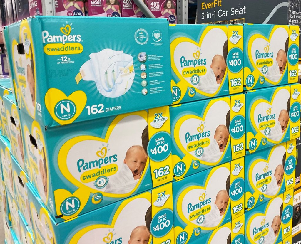 blue and yellow boxes of pampers swaddlers diapers at sam's club