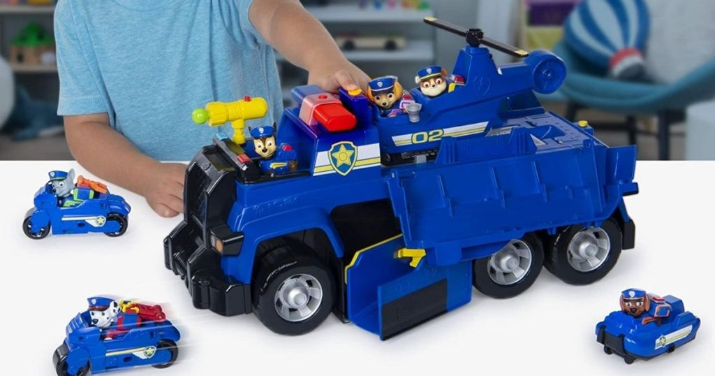 child playing with Paw Patrol Ultimate Police Cruiser with vehicles