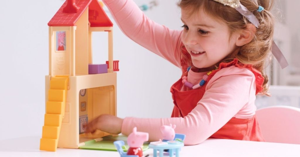 girl playing with Peppa Pig Play House