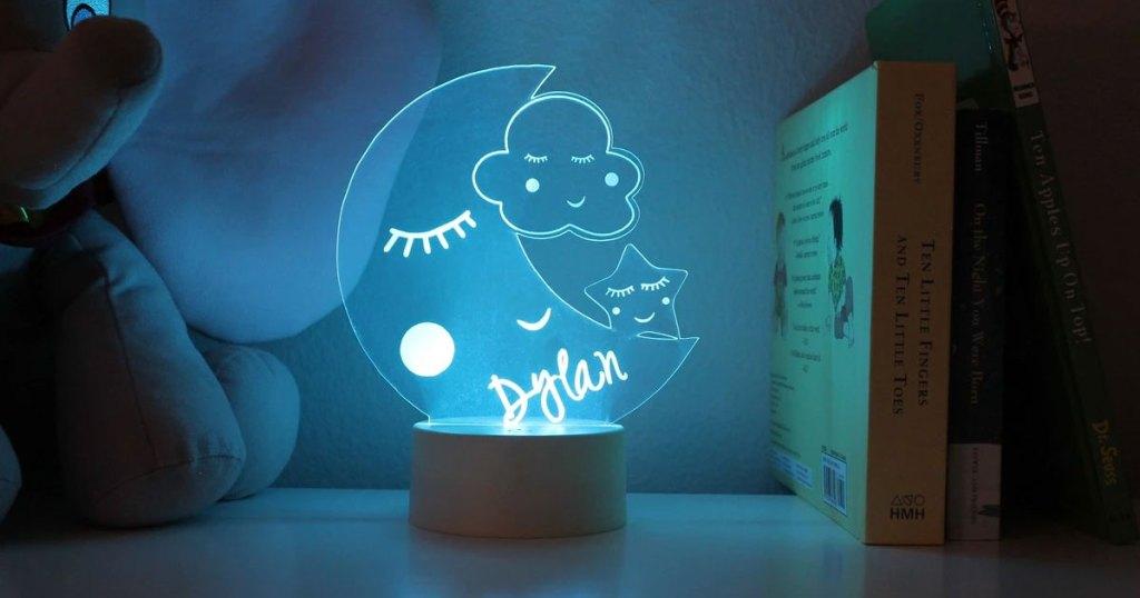personalized moon shaped nightlight glowing blue