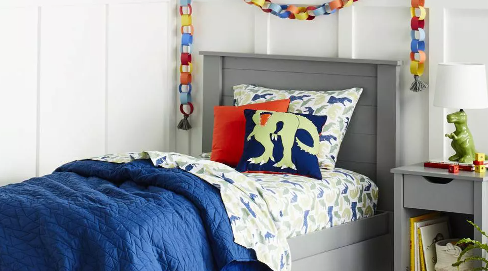 kids room with dinosaur decor and bedding
