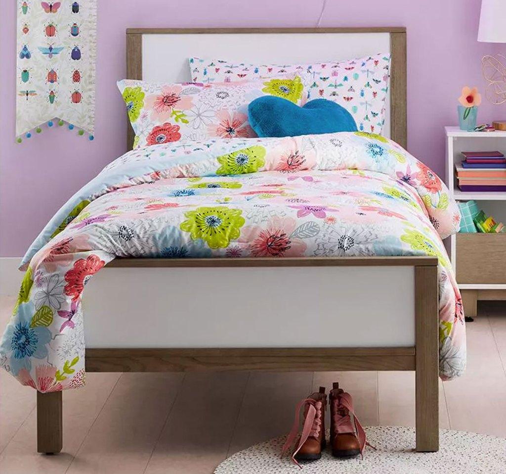 floral print comforter on a kids bed