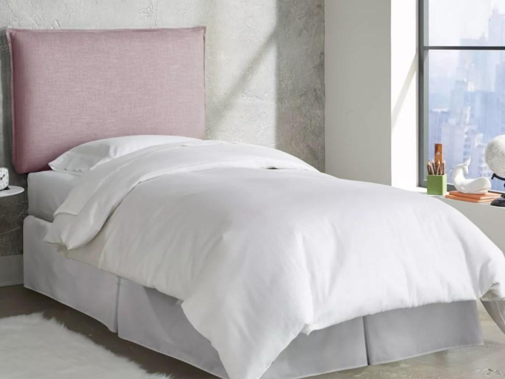 smokey rose quartz tufted headboard on a twin bed