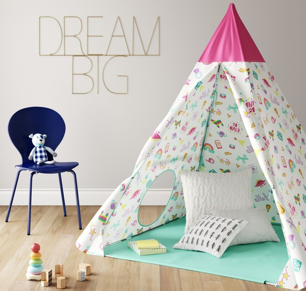 kids tent with a chair next to it