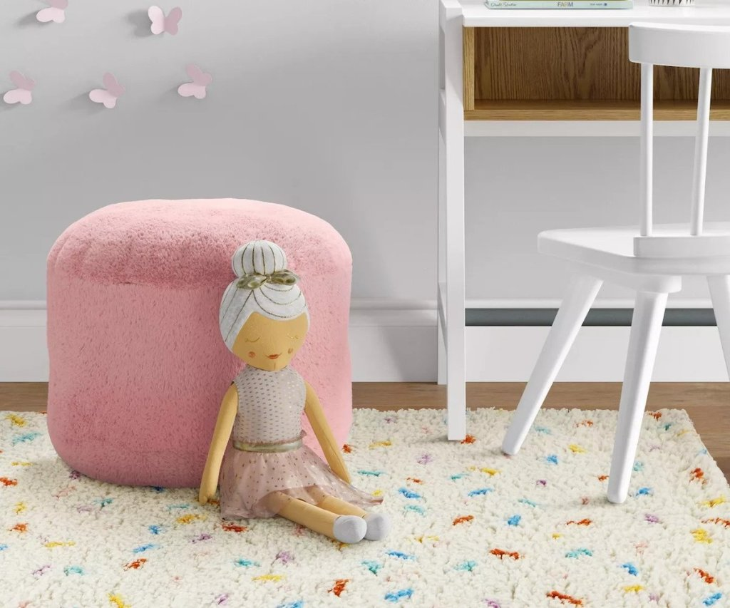 pink pillowfort pouf with ballerina stuffed animal