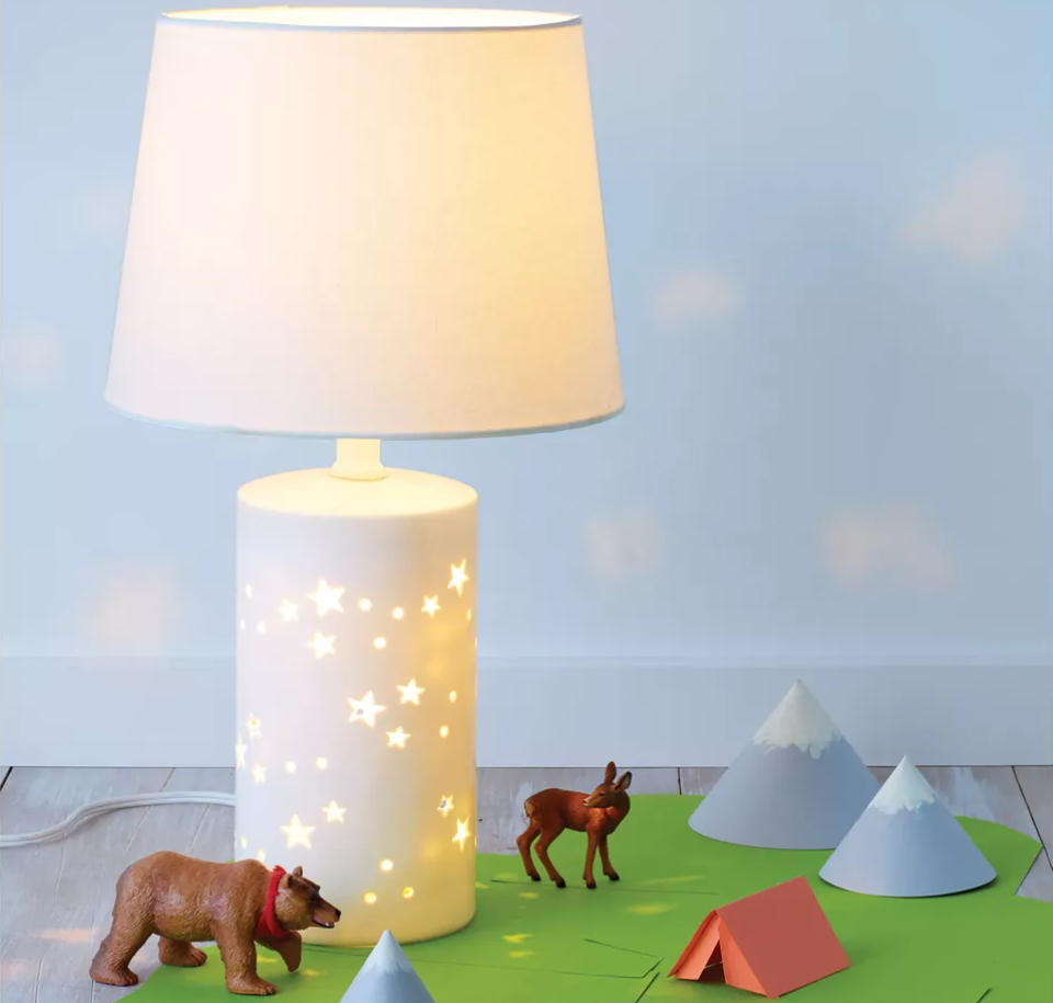 Pillowfort Star Lamp with toys around it