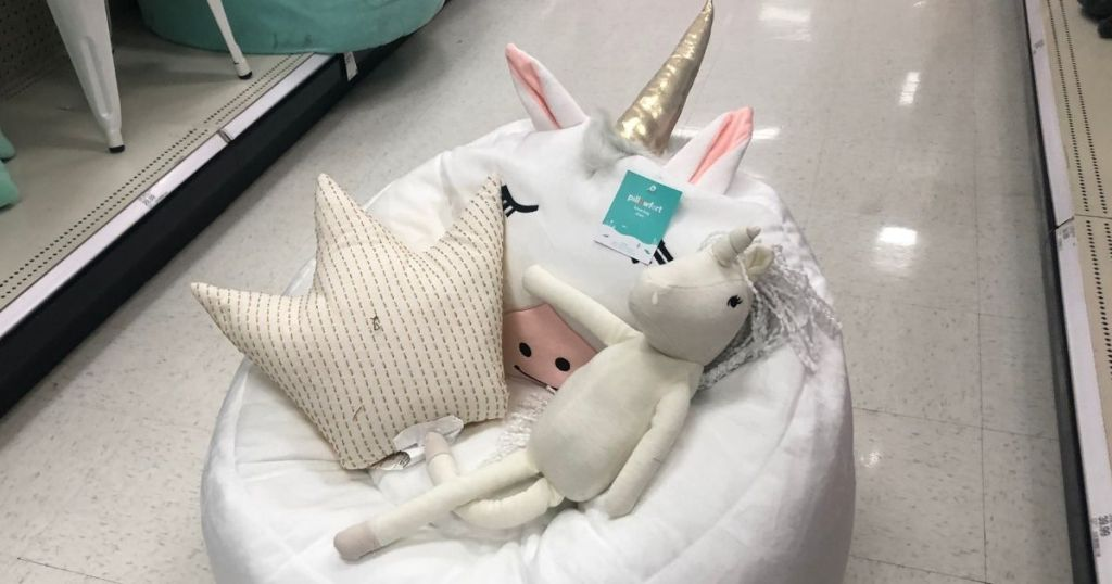 unicorn chair with toys in it